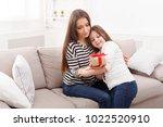 happy cute little girl giving... | Shutterstock . vector #1022520910