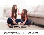 mother and daughter doing... | Shutterstock . vector #1022520958