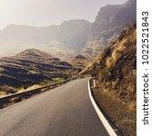 road between the mountains  | Shutterstock . vector #1022521843