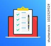 checklist on laptop screen.... | Shutterstock .eps vector #1022529529