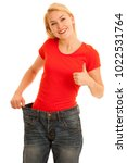 Small photo of Woman wears too big trousers as she loose weight - weightloss