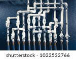 white plastic pipes in boiler... | Shutterstock . vector #1022532766
