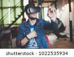 young man wearing virtual... | Shutterstock . vector #1022535934