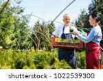 senior couple farming at garden ... | Shutterstock . vector #1022539300