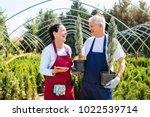 senior couple of gardeners... | Shutterstock . vector #1022539714