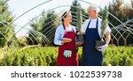 senior couple of gardeners... | Shutterstock . vector #1022539738