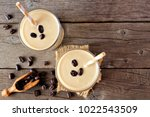 coffee  banana smoothie in two... | Shutterstock . vector #1022543509