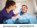 dentist looking patient   s... | Shutterstock . vector #1022550274