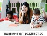 young asian woman teacher and... | Shutterstock . vector #1022557420