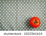 one red ripe tomato on the... | Shutterstock . vector #1022561614