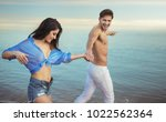 happy young couple having fun... | Shutterstock . vector #1022562364