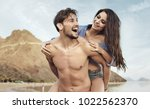 happy young couple having fun... | Shutterstock . vector #1022562370