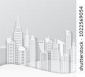 white paper skyscrapers.... | Shutterstock .eps vector #1022569054