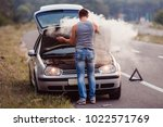 the car broke down  smokes from ... | Shutterstock . vector #1022571769
