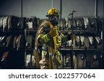 firefighter with gear in front... | Shutterstock . vector #1022577064
