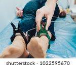 doctor with electrocardiogram...   Shutterstock . vector #1022595670