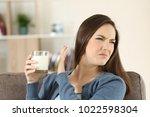 woman refusing a glass of milk... | Shutterstock . vector #1022598304