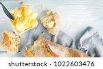 butter on a fresh crunchy... | Shutterstock . vector #1022603476