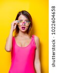 young girl in pink one piece... | Shutterstock . vector #1022604658