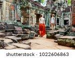 Family Visiting Ancient Preah...