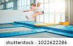 girl jumping high in striped...   Shutterstock . vector #1022622286