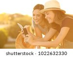 two happy tourists planning... | Shutterstock . vector #1022632330