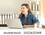 happy intern taking a vitamin... | Shutterstock . vector #1022632348