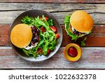 tasty burgers flat lay. two... | Shutterstock . vector #1022632378