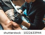 Tattoo Artist In Black Gloves...
