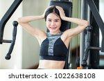 woman headache after exercise. | Shutterstock . vector #1022638108