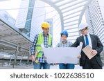 engineer discuss with team... | Shutterstock . vector #1022638510