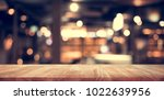 wood table top  bar  with blur... | Shutterstock . vector #1022639956