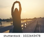 stretching after jogging... | Shutterstock . vector #1022643478