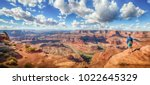 panoramic view of young hiker... | Shutterstock . vector #1022645329