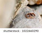 wedding rings lie on the rock.... | Shutterstock . vector #1022660290