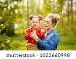 family time. the mother holds a ...   Shutterstock . vector #1022660998