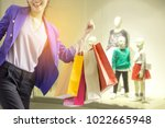 woman holding shopping bag in...   Shutterstock . vector #1022665948