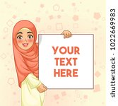 young muslim woman smiling... | Shutterstock .eps vector #1022669983