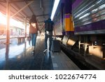 happy young couple on railway... | Shutterstock . vector #1022674774
