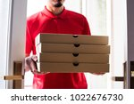 man delivery pizza to customer | Shutterstock . vector #1022676730
