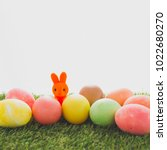 colorful easter eggs and rabbit ... | Shutterstock . vector #1022680270