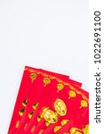 Small photo of Chinese New Year traditional concept with red envelope and many ingots contain Chinese character means happiness and good fortune, Good luck , and good chance, wishing you everything is all success