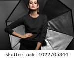 fashion portrait of young... | Shutterstock . vector #1022705344