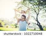 father gives her daughter... | Shutterstock . vector #1022710048
