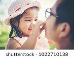 little girl hugging neck of her ... | Shutterstock . vector #1022710138