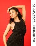 beautiful female model in black ... | Shutterstock . vector #1022724490
