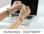 Hand Of Hacker With Handcuffs...