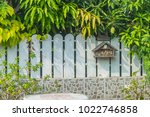 a quaint letterbox and a white... | Shutterstock . vector #1022746858