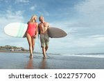 happy couple with surfboards on ... | Shutterstock . vector #1022757700