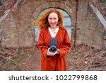 pretty photographer. long hair... | Shutterstock . vector #1022799868